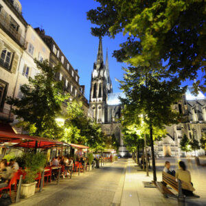 Restaurants at a square in front of the cathedral in the evening, Clermont Ferrand, Auvergne, France, Europe