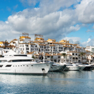 Marbella, Spain - October 13, 2016: White expensive luxury yachts moored in the marina of Puerto Jose Banus on the Costa del Sol on a cloudy Autumn morning,
